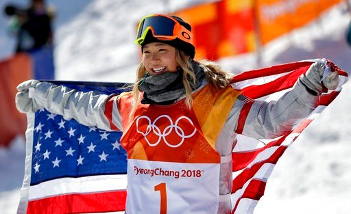 Chloe Kim, of the United States, celebrates winning gold after the women's halfpipe finals at Phoenix Snow Park at the 2018 Winter Olympics in Pyeongchang, South Korea, Tuesday, Feb. 13, 2018. (AP Photo/Gregory Bull)