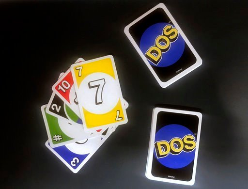 Dos has similar rules as Uno, except players make two piles of cards and can throw down two cards at a time instead of one. (AP Photo/Jenny Kane)