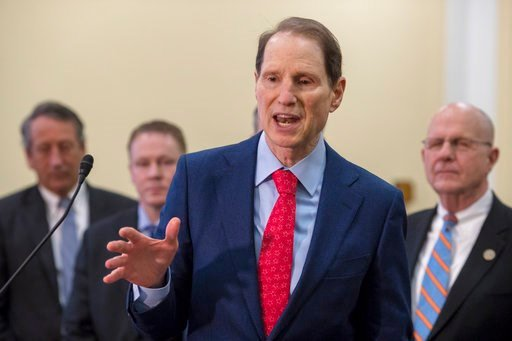 Sen. Ron Wyden, D-Ore., a member of the Senate Intelligence Committee, center, joins a bipartisan group of House and Senate lawmakers at a news conference where they were united in their insistence on reforms to the FISA Amendments Reauthorization Act of