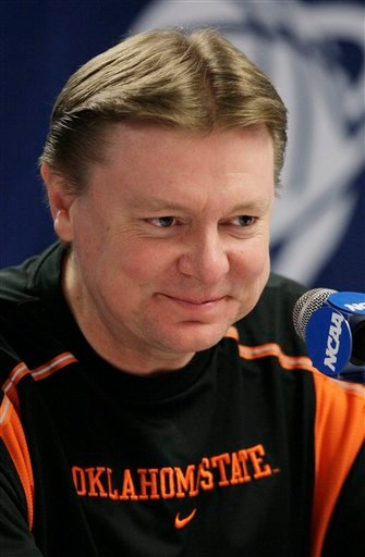In this March 21, 2010 file photo, Oklahoma State women's basketball head coach Kurt Budke grins during a news conference in Tempe, Ariz.