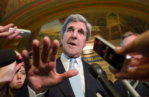 Supercommittee member Sen. John Kerry, D-Mass. meets with reporters on Capitol Hill in Washington, Thursday, Nov. 17, 2011, as he and fellow Supercommittee members emerged from a closed-door meeting. (AP Photo/J. Scott Applewhite)