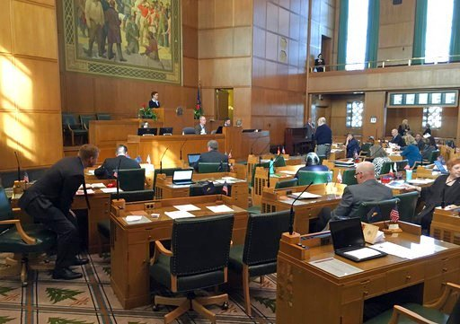 Oregon Representatives debate on the House floor at the Capitol in Salem, Ore., Tuesday, Feb. 13, 2018. Oregon's Legislature is considering taking a step toward enshrining the right to health care in its state Constitution, which would be unprecedented in