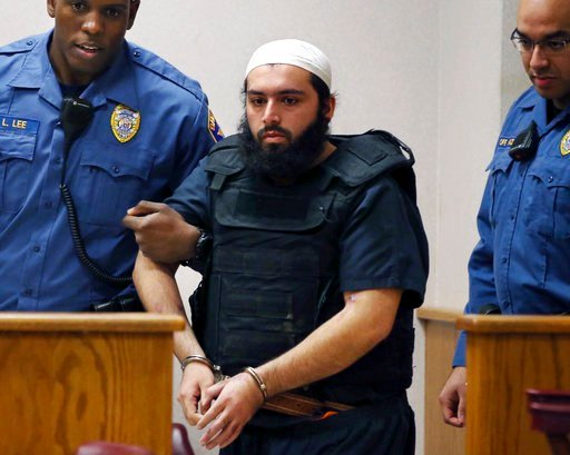 FILE - In this Dec. 20, 2016, file photo, Ahmad Khan Rahimi, center, is led into court in Elizabeth, N.J. (AP Photo/Mel Evans, File)
