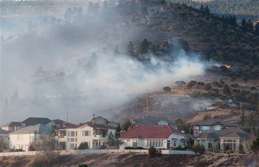 The 400-acre Caughlin Fire burns near homes in Reno, Nev. on Friday, Nov. 18, 2011. High winds are making it difficult to contain the fire. (AP Photo/Kevin Clifford)
