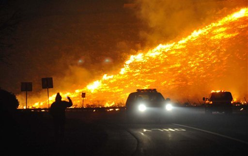 Emergency personnel respond to a wildfire in Reno, Nev. Friday, Nov. 18, 2011. (AP Photo/The Reno Gazette-Journal, Tim Dunn)