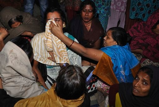 People react after a major fire broke out at the site of a congregation of eunuchs in the Nand Nagri area of New Delhi, India, Sunday, Nov.20, 2011. (AP)