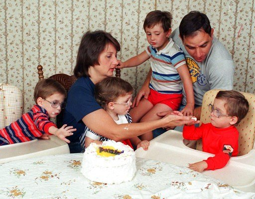 FILE - In this May 21, 1988 file photo, the three surviving Frustaci septuplets, Stephen, Patricia, and Richard, seated from left, join parents Patti and Sam Frustaci and older brother Joseph, 4, as they dig into cake to celebrate their third birthday in