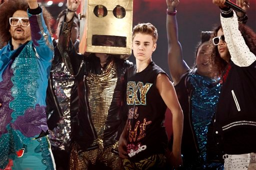 Justin Bieber dances onstage while LMFAO performs at the 39th Annual American Music Awards on Sunday, Nov. 20, 2011 in Los Angeles. (AP Photo/Matt Sayles)