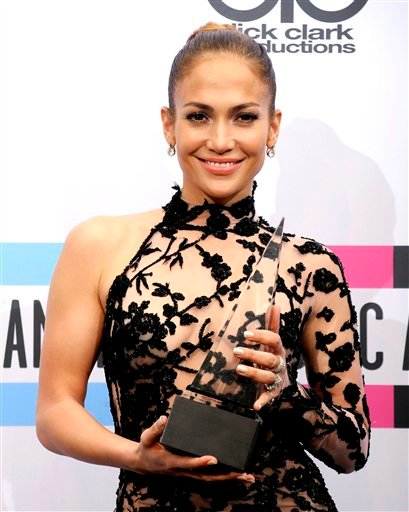 Jennifer Lopez poses backstage with her award for latin music favorite artist at the 39th Annual American Music Awards on Sunday, Nov. 20, 2011 in Los Angeles. (AP Photo/Chris Pizzello)