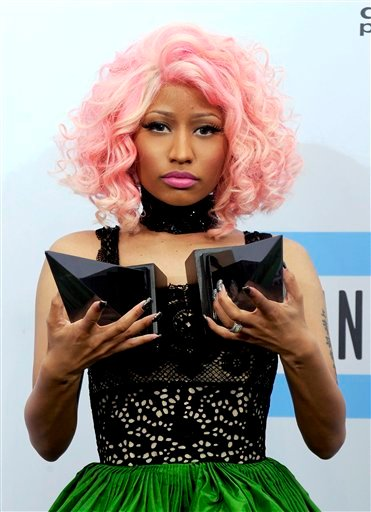 Nicki Minaj poses backstage with her award for rap/hip-hop favorite artist and rap/hip-hop favorite album at the 39th Annual American Music Awards on Sunday, Nov. 20, 2011 in Los Angeles. (AP Photo/Chris Pizzello)