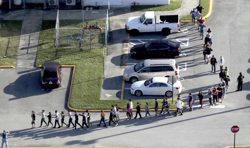 Fourteen wounded survivors were hospitalized as bodies were recovered from inside and around Marjory Stoneman Douglas High School.