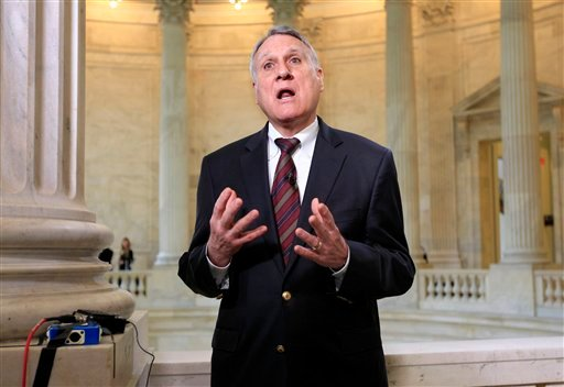 Supercommittee member Sen. Jon Kyl, R-Ariz. gestures during TV interview about the deficit reducing panel's unfinished work Monday, Nov. 21, 2011, on Capitol Hill in Washington.