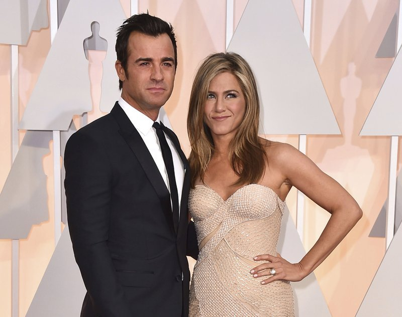 In this Feb. 22, 2015 file photo, Justin Theroux, left, and Jennifer Aniston arrive at the Oscars in Los Angeles. The couple announced Thursday, Feb. 15, 2018, that they have separated.