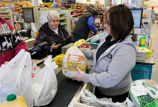 A clerk bags a turkey for a customer at Pixley's Shurfine grocery store in Akron, N.Y., Tuesday, Nov. 22, 2011.
