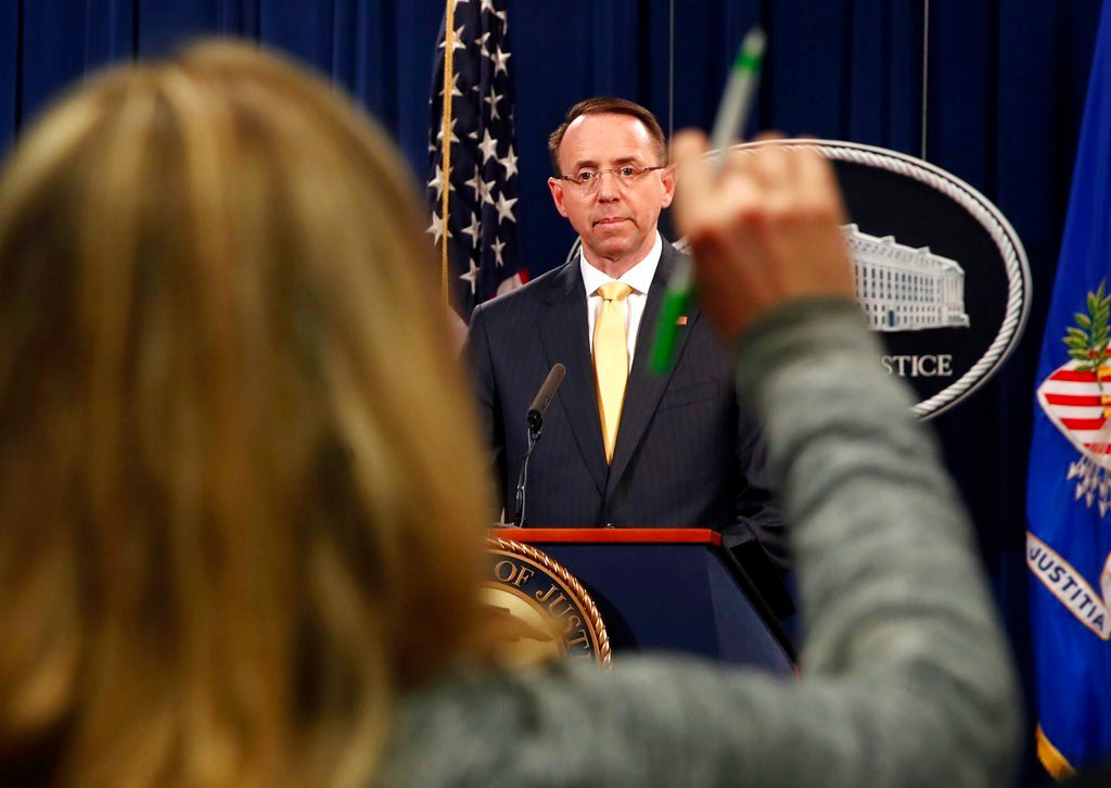A reporter raises her hands to ask a question of Deputy Attorney General Rod Rosenstein. (AP Photo/Jacquelyn Martin)