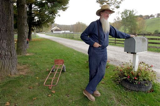 FILE - In this Oct. 10, 2011 file photo, Sam Mullet leans on the mailbox at his home in Bergholz, Ohio.