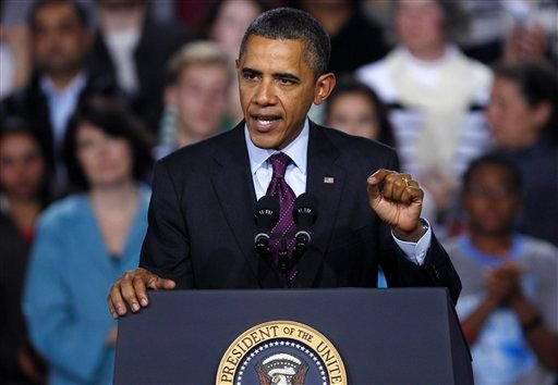 FILE - In this Nov. 22, 2011 file photo, President Barack Obama gestures while speaking at Central High School in Manchester, N.H.