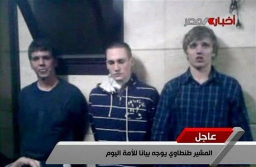 In this Tuesday, Nov. 22, 2011 file image from Egyptian state television, three American students are displayed to the camera by Egyptian authorities following their arrest during protests in Cairo, where an Egyptian official said they were throwing fire