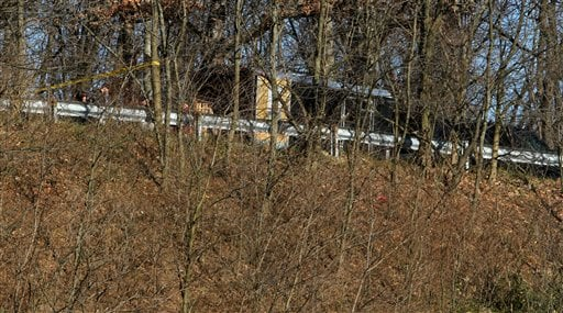 Law enforcement officials work at a crime scene on Harlem Road in Akron, Ohio, where a body was found on Friday, Nov. 25, 2011.