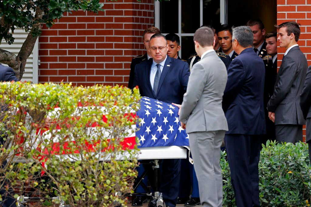 The casket of Alaina Petty, a victim of Wednesday's mass shooting at Marjory Stoneman Douglas High School, leaves her funeral in Coral Springs, Fla., Monday, Feb. 19, 2018. (AP Photo/Gerald Herbert)