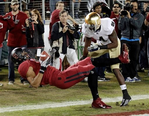 Stanford tight end Levine Toilolo catches a touchdown pass in front of Notre Dame cornerback Gary Gray (4) in the first quarter of an NCAA college football game in Stanford, Calif., Saturday, Nov. 26, 2011. (AP Photo/Paul Sakuma)