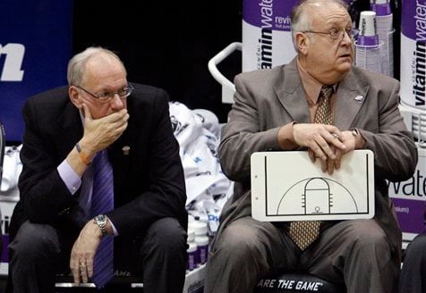 In this March 25, 2010, file photo, Syracuse coach Jim Boeheim, left, and associate head basketball coach Bernie Fine sit on the bench at the end an NCAA West Regional semifinal college basketball game against Butler in Salt Lake City. (AP)