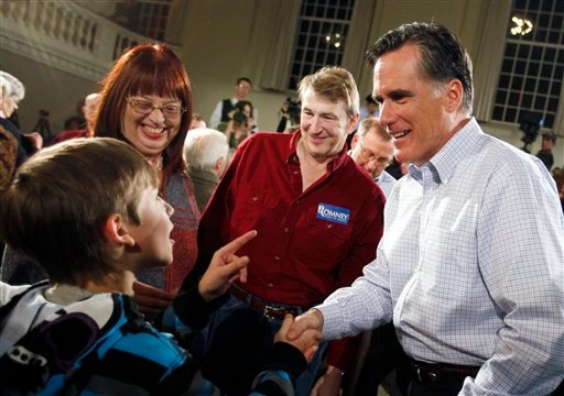 FILE - In this Nov. 19, 2011, file photo Republican presidential hopeful, former Massachusetts Gov. Mitt Romney, right, greets a young supporter during a town hall event in Peterborough, N.H.