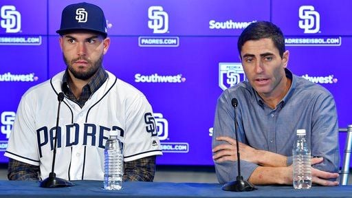 San Diego Padres baseball player Eric Hosmer, left, listens as Padres general manager A.J. Preller speaks during an introductory press conference in Peoria, Ariz., Tuesday, Feb. 20, 2018.