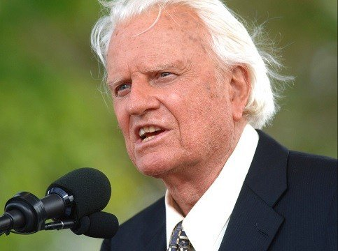 Rev. Billy Graham speaks on stage on the third and last day of his farewell American revival in the Queens borough of New York.