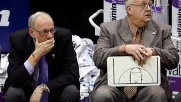 In this March 25, 2010, file photo, Syracuse coach Jim Boeheim, left, and associate head basketball coach Bernie Fine sit on the bench at the end an NCAA West Regional semifinal college basketball game. (AP Photo/Steve C. Wilson, File)