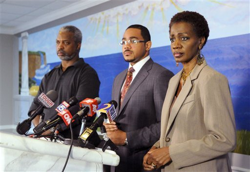 Robert Champion Sr, left, his wife, Pam, right, and their attorney Christopher Chestnut participate in a news conference on Monday, Nov. 28, 2011, in Lithonia, Ga.