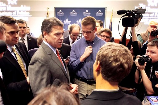 Republican presidential candidate, Texas Gov. Rick Perry meets with students after speaking at St. Anselm's College during a campaign stop, Tuesday, Nov. 29, 2011, in Manchester, N.H.
