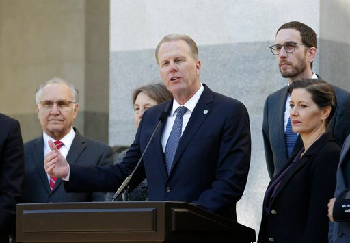 San Diego Mayor Kevin Faulconer, center, discusses California's growing homeless crisis during a news conference, Wednesday, Feb. 21, 2018, in Sacramento, Calif.(AP Photo/Rich Pedroncelli)