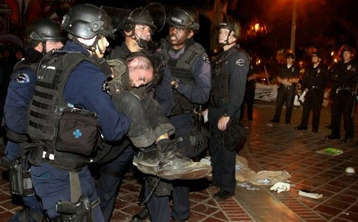 LAPD officers arrest an Occupy LA protester as they cleared out the Occupy L.A. camp at Los Angeles city hall on Wednesday, Nov. 30, 2011. (AP Photo/Mark Boster, Pool)