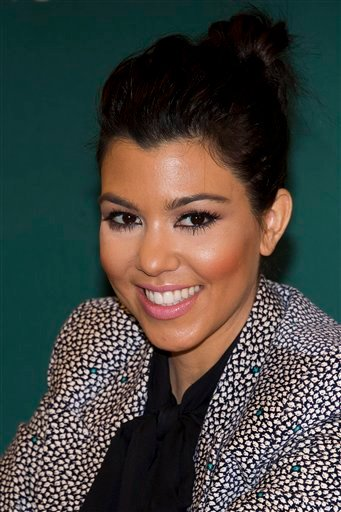 """In this Nov. 16, 2011 photo, Kourtney Kardashian attends a book signing for """"Dollhouse,"""" the novel she co-wrote with her sisters, at Barnes & Noble in New York. Kardashian and her boyfriend, Scott Disick."""