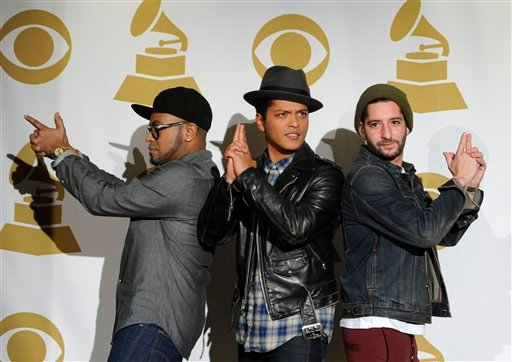 From left, Philip Lawrence, Bruno Mars, and Ari Levine are seen backstage at the Grammy Nominations Concert on Wednesday, Nov. 30, 2011 in Los Angeles. (AP Photo/Chris Pizzello)