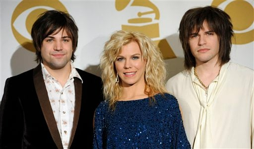 The Band Perry, from left, Neil Perry Kimberly Perry, and Reid Perry, are seen at the Grammy Nominations Concert on Wednesday, Nov. 30, 2011 in Los Angeles. (AP Photo/Chris Pizzello)