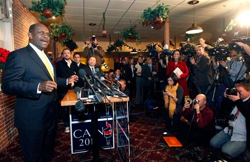 Republican presidential candidate Herman Cain speaks during a news conference in Manchester, N.H., Wednesday, Nov. 30, 2011. (AP Photo/Elise Amendola)