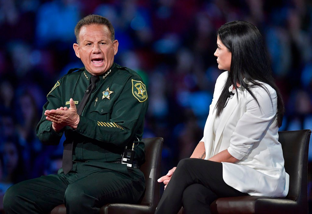 Broward Sheriff Scott Israel makes a point to NRA Spokesperson Dana Loesch during a town hall meeting, Wednesday, Feb. 21, 2018, at the BB&T Center, in Sunrise, Fla. (Michael Laughlin/South Florida Sun-Sentinel via AP)