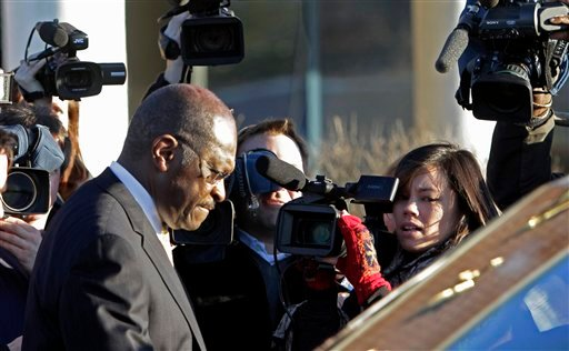 Republican presidential candidate, Herman Cain leaves the Manchester Union Leader newspaper after meeting with the editorial board, Thursday, Dec. 1, 2011, in Manchester, N.H.