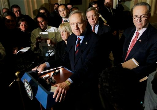 Senate Majority Leader Harry Reid of Nev., center, accompanied by Sen. Patty Murray, D-Wash., Senate Majority Whip Richard Durbin of Ill., and Sen. Charles Schumer, D-N.Y., speaks to reporters about extending the payroll tax cut, Thursday, Dec. 1, 2011.