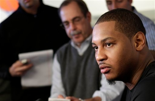 New York Knicks' Carmelo Anthony speaks to the media after working out at their practice facility in Greenburgh, N.Y., Thursday, Dec. 1, 2011.