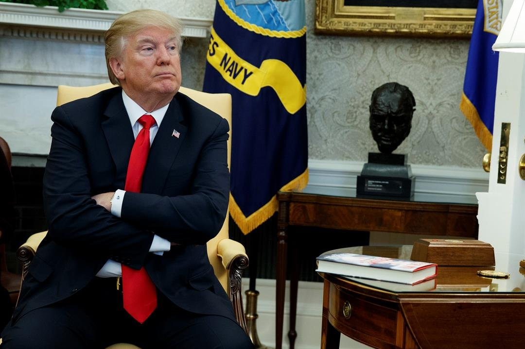 In this file photo, President Donald Trump listens during a meeting with North Korean defectors where he talked with reporters about allowing the release of a secret memo on the FBI's role in the Russia inquiry. (AP Photo/Evan Vucci, File)