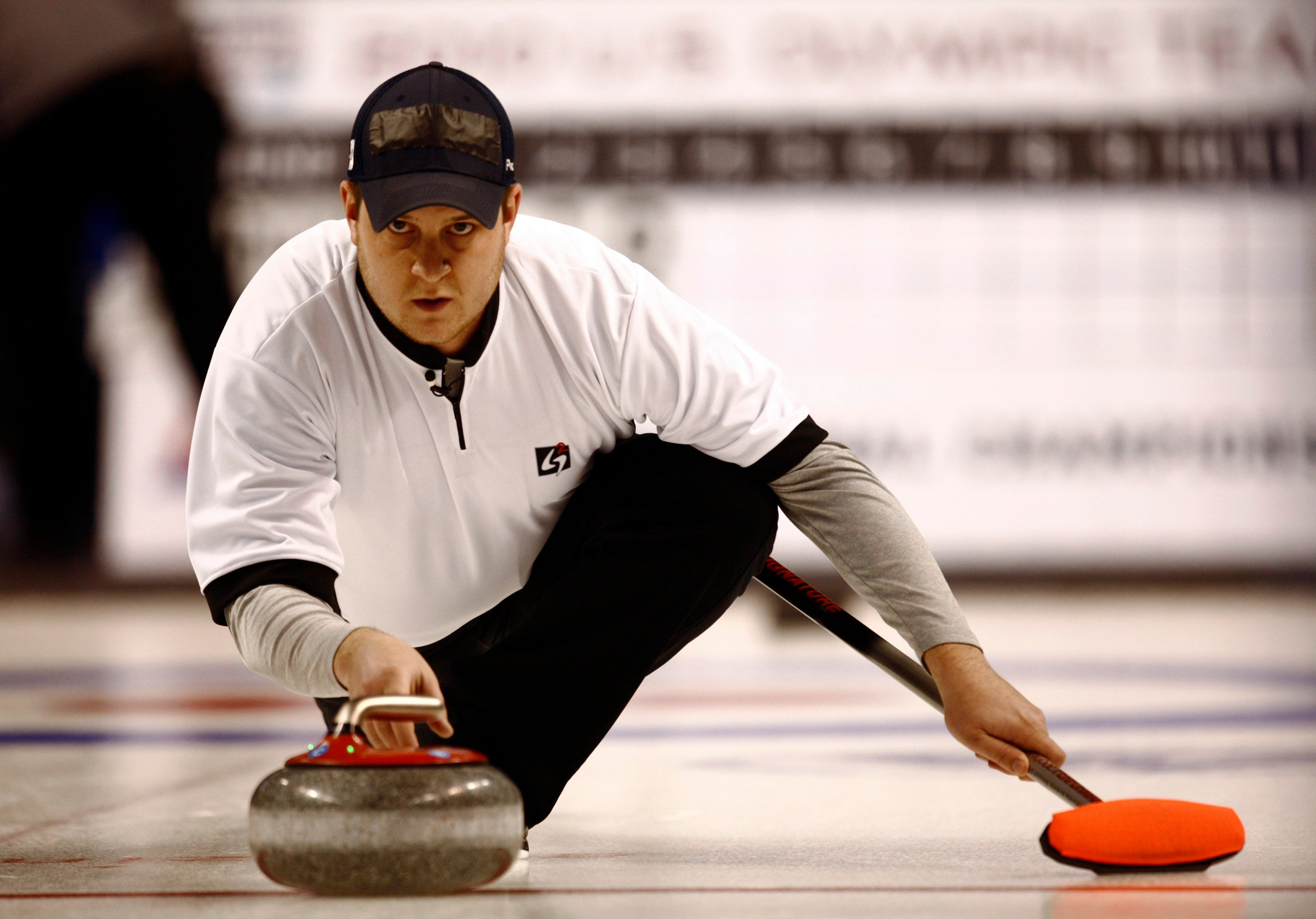 Skip John Schuster of Duluth, Mn., thorws a stone in the mens final at the U.S. Curling Trials. Schuster and his three teammates won gold in the 2018 Winter Olympics. (AP Photo/David Zalubowski)