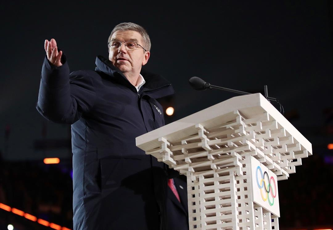 Thomas Bach, president of the IOC, speaks during the opening ceremony of the Winter Olympics. The IOC executive board has recommended upholding the ban of Russia from the Winter Games. (Clive Mason/Pool Photo via AP)