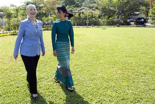 Myanmar's pro-democracy opposition leader Aung San Suu Kyi, right, and U.S. Secretary of State Hillary Rodham Clinton tour the grounds after meetings at Suu Kyi's residence in Yangon, Myanmar Friday, Dec. 2, 2011.