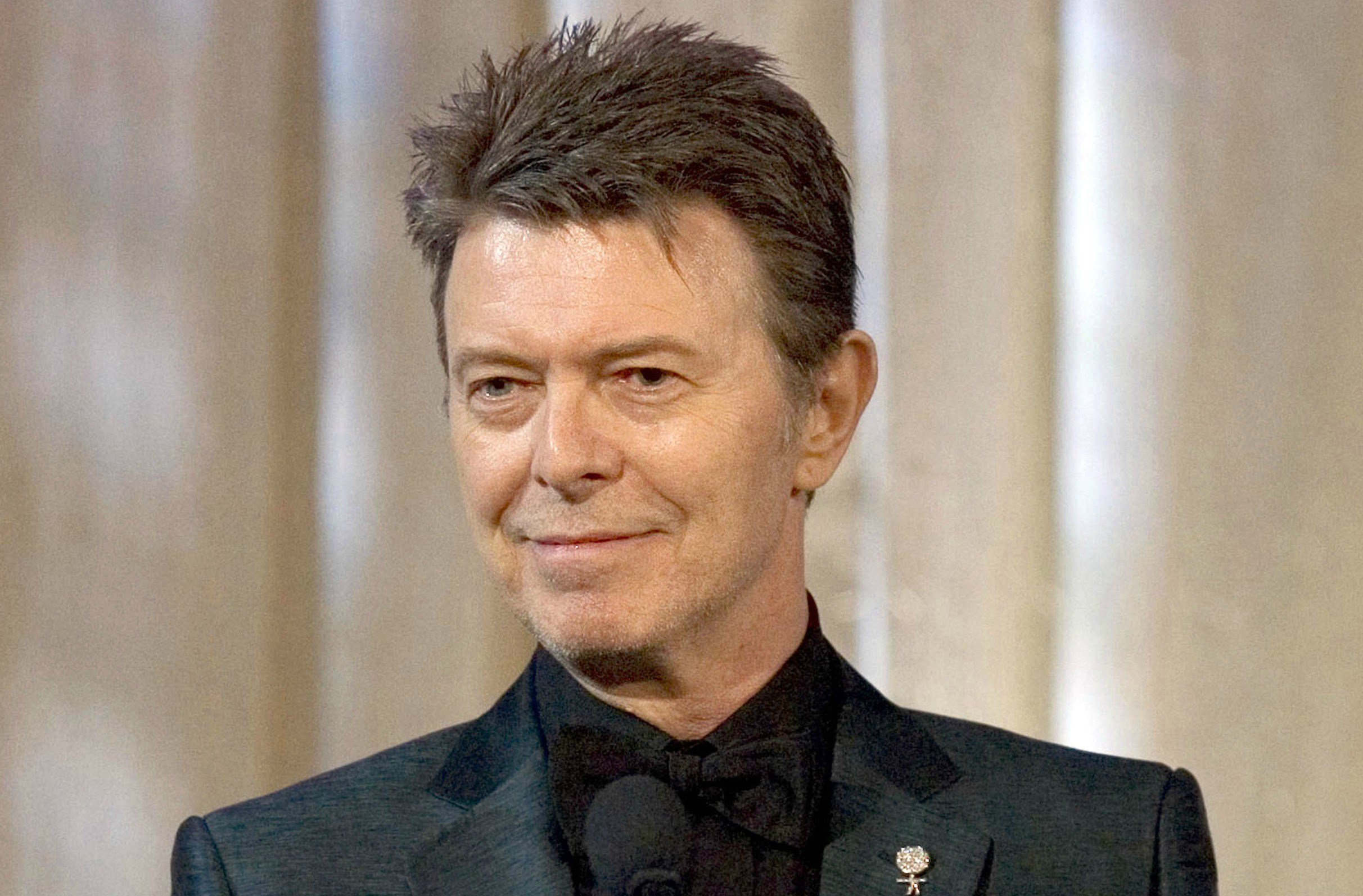 In this June 5, 2007 file photo, singer David Bowie accepts the lifetime achievement award at the 11th Annual Webby Awards in New York. (AP Photo/Stephen Chernin, File)