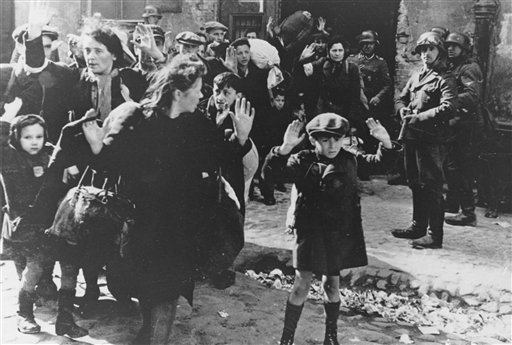 FILE- In this April 19, 1943 file photo, a group of Jews areescorted from the Warsaw Ghetto by German soldiers.