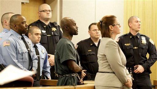 Arthur Morgan III, center, appears in court at Monmouth Country Courthouse, Monday, Dec. 5, 2011, in Freehold, N.J.