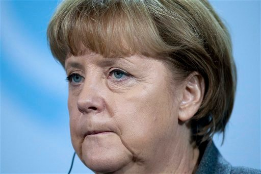 German Chancellor Angela Merkel reacts during a news conference with Afghan President Afghan President Hamid Karzai where she has to answers questions about the the news that Standard & Poor's is examining the credit rating of 15 eurozone countries. (AP)